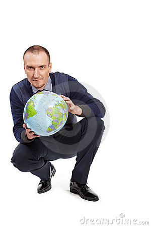 Man with ball-globe in position half squatting. Stock Photo