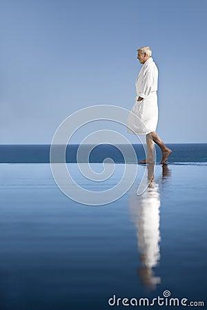 Man in bathrobe by the pool