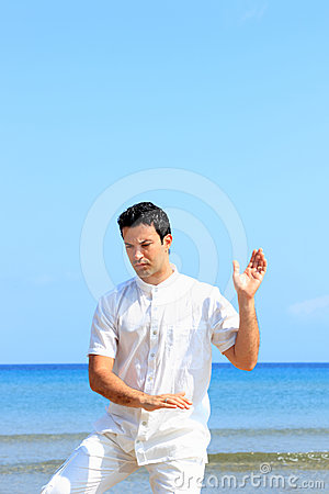 Man on the beach meditating