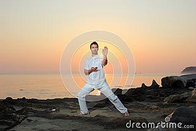 Man on the beach meditating