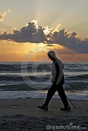 Man on beach at sunset