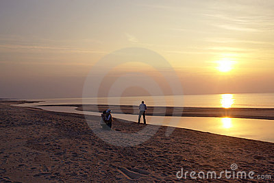 Man on beach at sunset