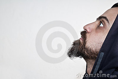 Man with beard and cap looks into the void