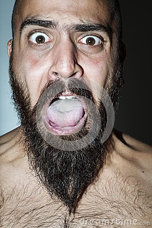 Man with beard with frightening expressions