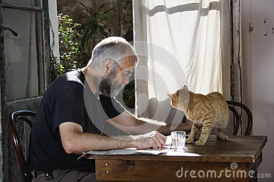 Man with beard and his cat