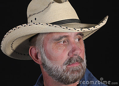 A Man with a Beard in a White Cowboy Hat