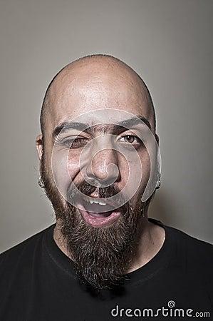 Man with beard winks