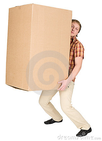 Man bears the big heavy cardboard box