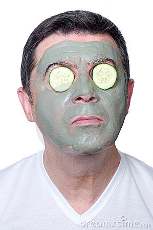 Man with beauty mask and slice