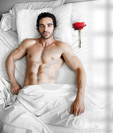 Man in bed with rose