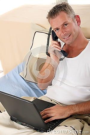 Man bedroom laptop