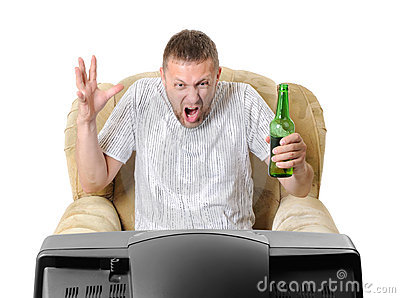Man with beer in an armchair watches TV