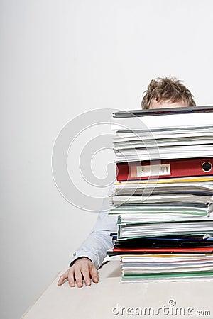 Free Man Behind Paperwork Royalty Free Stock Images - 9472489
