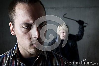 Man being stalked by criminal