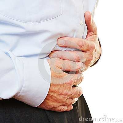 Man with bellyache holding stomach