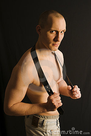 Man with belt on neck