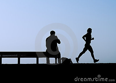 Man on bench watches jogger
