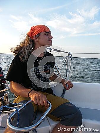Man beyond the yacht steering