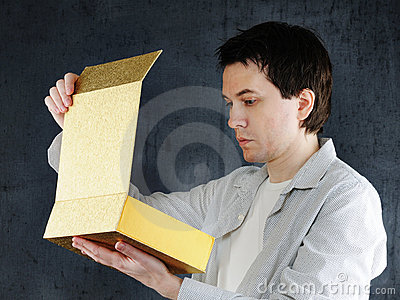 Man with big golden box.