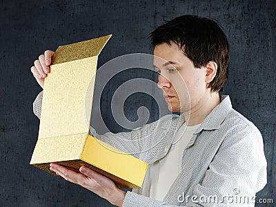 Man with big golden box.