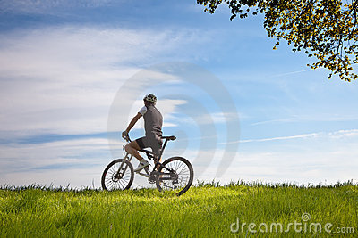Man on a bike in a field
