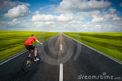 Man biking on road