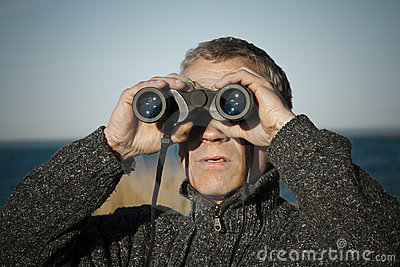 A man with binoculars