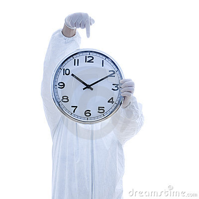 Man in biohazard suit holding clock.