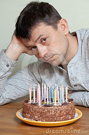 Man at birthday cake