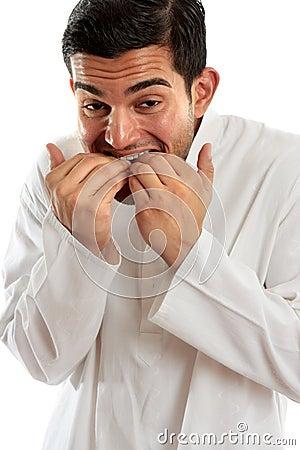 Man biting fingernails anxiety stress or terrified