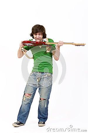 Man biting the guitar