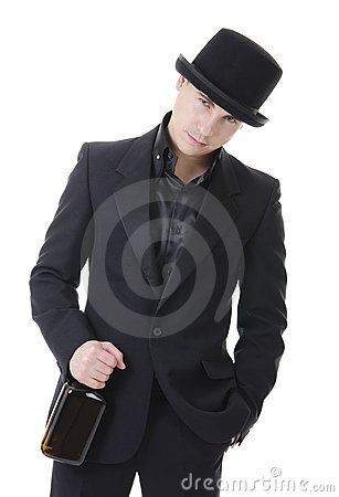 Man in black austere suit and hat with whisky