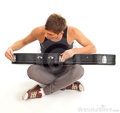 Man with black case on guitar
