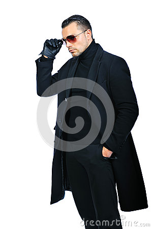 Fashionable man in black coat isolated oover white background