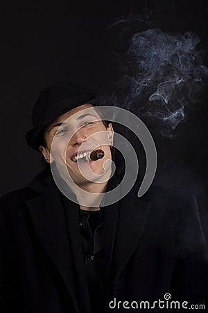 Man in black hat smoke cigar and smile