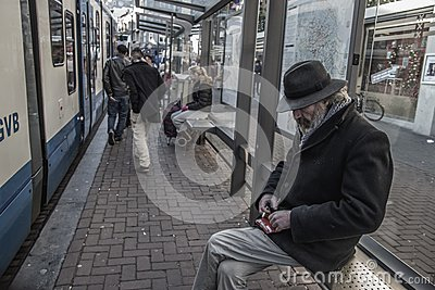 Man In Black Jacket Sitting At The Train Station Free Public Domain Cc0 Image