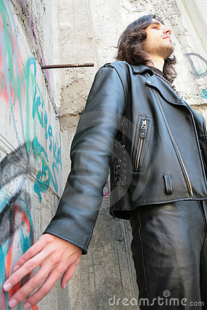 Man in black leather cloth in gothic style