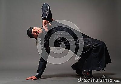 Man in a black raincoat