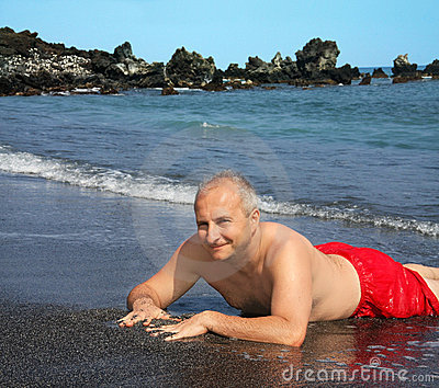 Man on Black sand beach