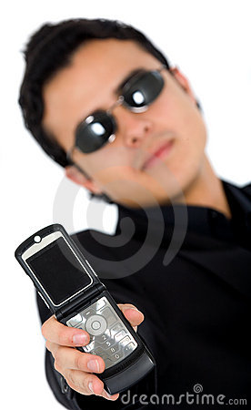 Man in black showing a phone