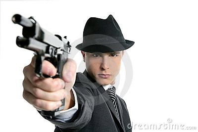 Man with black suit and gun