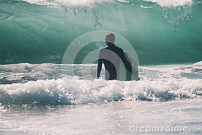 Man In Black Suit Holding Surfing Board Beside The Wave During Daytime Free Public Domain Cc0 Image