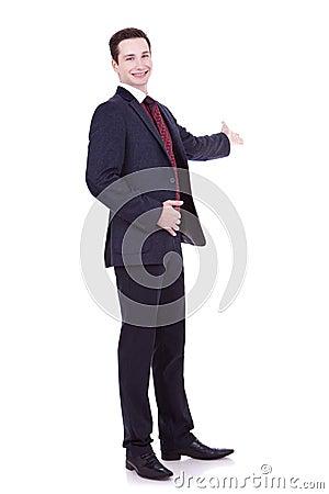 Man in black suit making presentation