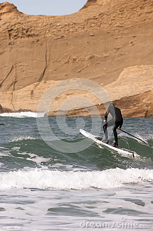 Free Man Black Wetsuit Ocean Surf Riding Paddle Board Summer Sport Royalty Free Stock Image - 41141476