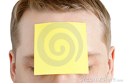 Man with a blank adhesive note on the forehead