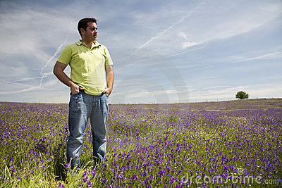 Man at the blooming meadow