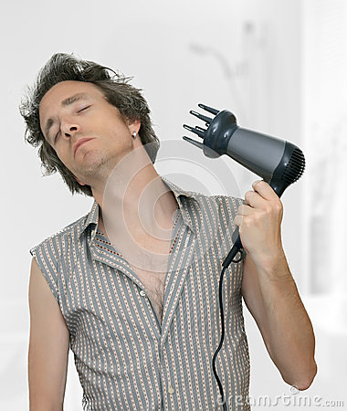 Man blow drying his hair