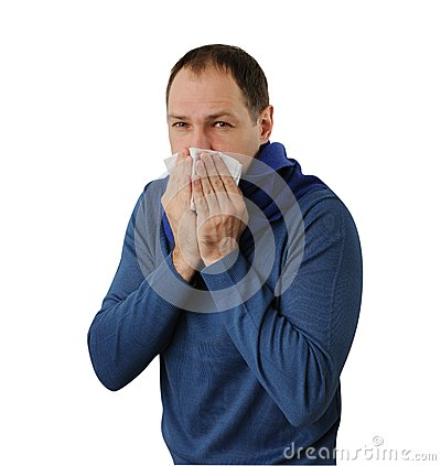 Man blowing his nose isolated on white
