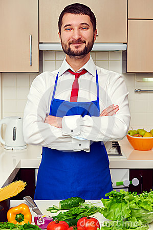Man in blue apron with folded hands