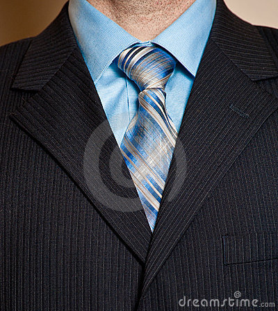 Man in blue business suit detail.